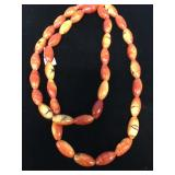 "Coral bead necklace about 15.5"" long"