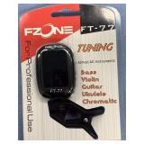 New in package stringed instrument tuner    (p 1)
