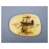 Scrimmed ivory platchet with sailing ship and a go