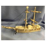 Fossilized whale bone and ivory and ship, by Eric