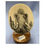 Scrimshaw wooly mammoth on mammoth ivory, burl woo