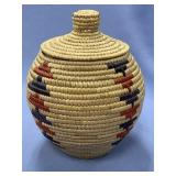 Lidded Hooper Bay grass basket with dyed accents a