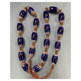 Large strand of blue chevron trade beads with dark