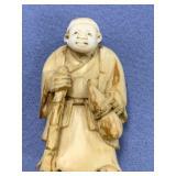 "Ivory netsuke of a man with cane and wine jug 2"" t"
