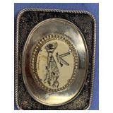 E. Milligruk brass belt buckle with fossilized ivo