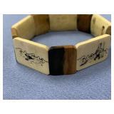 Ivory stretch bracelet made from fossilized dark i