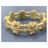 Bone carved bracelet, with floral shaped beads and