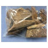 Bag full of bones and ivory artifacts (M 613)