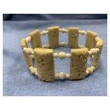 Hand carved bone stretch bracelet with ivory space