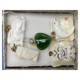 Small box containing 5 pendants, 2 are walrus ivor