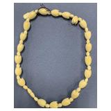Ivory necklace w/floral carved beads and ivory scr