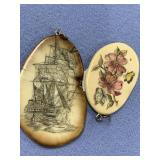 Lot of 2 scrimshaw fossilized ivory pendants (3)