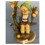 Hummel figurine of a young boy in an apple tree, a