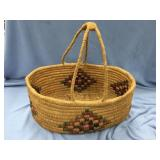 Interesting hand woven grass basket with handles a