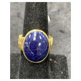 Fashion ring size 7 1/2 with blue stone cab insert