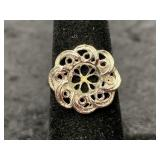 Fashion ring size 6 1/2 with floral center piece