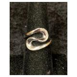 Fashion ring size 8 with abstract design       (M