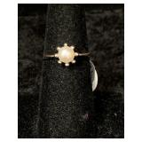 Fashion ring size 7 1/2 simulated pearl centerpiec