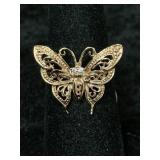Fashion ring size 6 1/2 with butterfly shaped cent