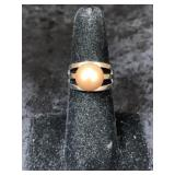 Fashion ring size 6 1/2 simulated pearl centerpiec
