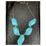 Necklace with 5 polished stone pieces on chain abo