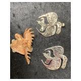 Tlingit raven pendant, brooch and a copper toned b