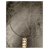 Abstract pendant on rubber cord    (M 91)