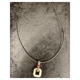 Modern steel pendant on rubber cord    (M 91)