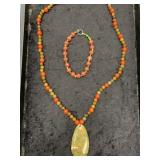 Stone and glass beaded necklace with stone pendant