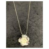 Floral shaped pendant on chain         (M 91)