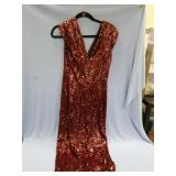 Lovely red sequined evening gown, split down back