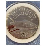 1 troy ounce silver coin, commemorating the Columb
