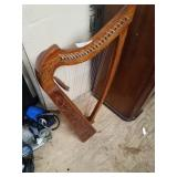Beautifully decorated wood made harp, length appro