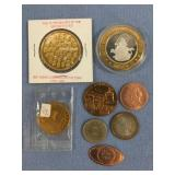 Small lot of coins including silver $10 gaming tok