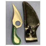 Skinning knife with dyed green handle, leather