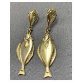 Pair of sterling silver earrings, each one has