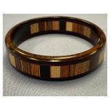 Stacked wood bracelet made from assorted exotic