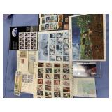 Lot of 2 envelopes full of unused stamps and a pac