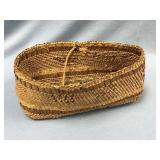 """Old hand woven cedar root basket about 8"""" long"""