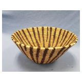 Hand woven grass basket with interesting dyed