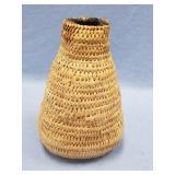 Old hand woven willow root jug sealed with pitch