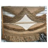 Interesting hand woven woolen wall décor, with