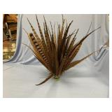 Interesting display of pheasant feathers on weight