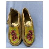 Pair of old leather slippers with beautiful hand b
