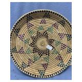 Hand woven grass tray with multi-colored dyed acce