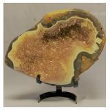 Fabulous geode specimen mounted on heavy metal bas