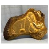 Michael Scott relief carving of a wooly mammoth on