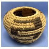 """Small hand woven grass basket about 5"""" diameter"""