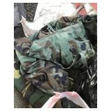 Plastic bag with military clothes, rain coats, etc