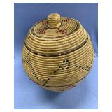 """Lidded grass basket about 17"""" tall with dyed seal"""